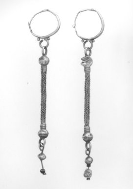 <em>Earrings with Composite Pendants</em>, 6th-7th century C.E. Gold, glass, pearl, 05.464a: 4 9/16 in. (11.6 cm). Brooklyn Museum, Ella C. Woodward Memorial Fund, 05.464a-b. Creative Commons-BY (Photo: Brooklyn Museum, CUR.05.464a-b_NegB_print_bw.jpg)