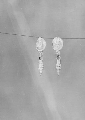 Roman. <em>Earrings</em>, 3rd century C.E. Gold, 05.466.1: 1 1/4 in. (3.1 cm). Brooklyn Museum, Ella C. Woodward Memorial Fund, 05.466.1-.2. Creative Commons-BY (Photo: Brooklyn Museum, CUR.05.466.1-.2_NegA_print_bw.jpg)