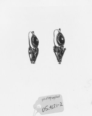 Roman. <em>Earrings</em>, 3rd century C.E. Gold, garnet, Length: 1 in. (2.6 cm). Brooklyn Museum, Ella C. Woodward Memorial Fund, 05.467.1-.2. Creative Commons-BY (Photo: Brooklyn Museum, CUR.05.467.1-.2_NegB_print_bw.jpg)