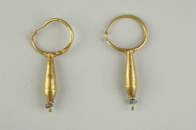 Coptic. <em>Earrings</em>, 6th-7th century C.E. Gold, glass, Average dimensions: 2 1/2 x 1 1/16 in. (6.3 x 2.7 cm). Brooklyn Museum, Ella C. Woodward Memorial Fund, 05.472.1-.2. Creative Commons-BY (Photo: Brooklyn Museum (in collaboration with Index of Christian Art, Princeton University), CUR.05.472.1_05.472.2_view1_ICA.jpg)