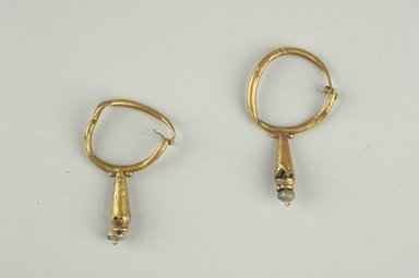 <em>Pair of Earrings</em>, 6th-7th century C.E. Gold, glass, 1 5/8 in. (4.1 cm). Brooklyn Museum, Ella C. Woodward Memorial Fund, 05.474.1-.2. Creative Commons-BY (Photo: Brooklyn Museum (in collaboration with Index of Christian Art, Princeton University), CUR.05.474.1_05.474.2_view1_ICA.jpg)