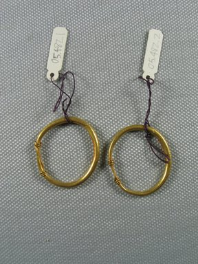 Roman. <em>Earrings</em>, 2nd-3rd century C.E. Gold, Diam: 1 1/8 in. (2.9 cm). Brooklyn Museum, Ella C. Woodward Memorial Fund, 05.482.1-.2. Creative Commons-BY (Photo: Brooklyn Museum, CUR.05.482.1-.2_overall.jpg)