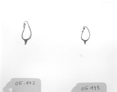 Roman. <em>Single Earring</em>, 2nd-3rd century C.E. Gold, 15/16 in. (2.4 cm). Brooklyn Museum, Ella C. Woodward Memorial Fund, 05.492. Creative Commons-BY (Photo: , CUR.05.492_05.493_NegID_05.492_GRPA_print_bw.jpg)