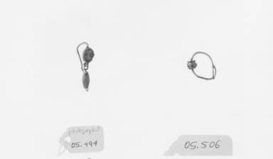 Roman. <em>Earring</em>, 2nd century C.E. Gold, glass, 1 1/8 in. (2.8 cm). Brooklyn Museum, Ella C. Woodward Memorial Fund, 05.494. Creative Commons-BY (Photo: , CUR.05.494_05.506_NegID_05.494_GRPA_print_bw.jpg)