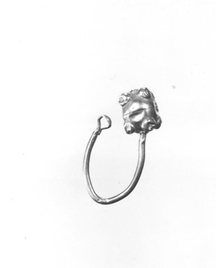 Roman. <em>Single Earring</em>, 6th-7th century C.E. Gold, 1/2 x 1 in. (1.2 x 2.5 cm). Brooklyn Museum, Ella C. Woodward Memorial Fund, 05.504. Creative Commons-BY (Photo: Brooklyn Museum, CUR.05.504_NegA_print_bw.jpg)
