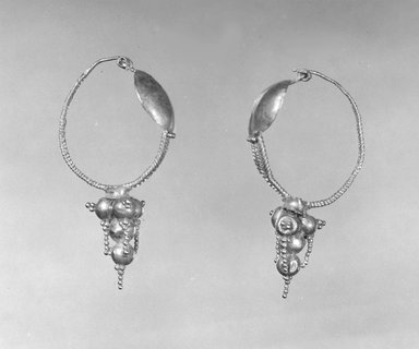 Roman. <em>Earrings</em>, 3rd century C.E. Gold, Average Length: 1 1/2 in. (3.8 cm). Brooklyn Museum, Ella C. Woodward Memorial Fund, 05.511.1-.2. Creative Commons-BY (Photo: Brooklyn Museum, CUR.05.511.1-.2_NegA_print_bw.jpg)