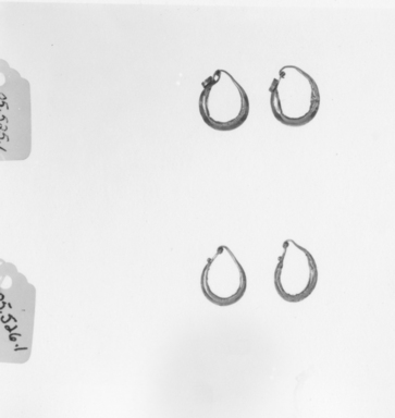Roman. <em>Pair of Earrings</em>, 2nd-3rd century C.E. Gold, 9/16 in. (1.5 cm). Brooklyn Museum, Ella C. Woodward Memorial Fund, 05.526.1-.2. Creative Commons-BY (Photo: , CUR.05.525.1-.2_05.526.1-.2_NegID_05.525.1-.2_GRPA_print_bw.jpg)