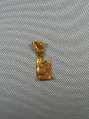 <em>Sheet Amulet with Relief Representations of Goddess Neith Squatting on Hieroglyph of Her Name</em>. Gold, 1 7/16 x 5/8 x 1/16 in. (3.7 x 1.6 x 0.1 cm). Brooklyn Museum, Charles Edwin Wilbour Fund, 05.576.6. Creative Commons-BY (Photo: Brooklyn Museum, CUR.05.576.6_view01.jpg)
