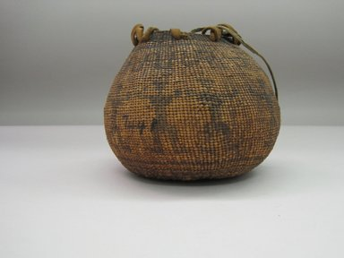 Yurok. <em>Globular (Tobacco?) Basket with Flat Lid and Carrying Thongs</em>. Fiber, leather, 5 5/16 × 3 3/8 × 3 3/8 in. (13.5 × 8.5 × 8.5 cm). Brooklyn Museum, Museum Expedition 1905, Museum Collection Fund, 05.588.7441. Creative Commons-BY (Photo: Brooklyn Museum, CUR.05.588.7441.jpg)