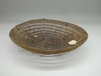 Hupa. <em>Basket Tray</em>. Fiber, 3 1/4 × 13 11/16 × 13 13/16 in. (8.3 × 34.8 × 35.1 cm). Brooklyn Museum, Museum Expedition 1905, Museum Collection Fund, 05.588.7454. Creative Commons-BY (Photo: Brooklyn Museum, CUR.05.588.7454.jpg)