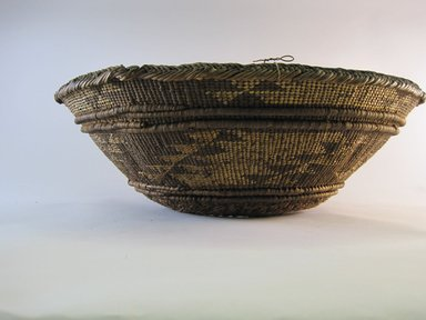 Hupa. <em>Mortar Rim</em>. Plant fiber, 5 9/16 × 17 1/8 × 17 3/16 in. (14.1 × 43.5 × 43.7 cm). Brooklyn Museum, Museum Expedition 1905, Museum Collection Fund, 05.588.7465. Creative Commons-BY (Photo: Brooklyn Museum, CUR.05.588.7465.jpg)