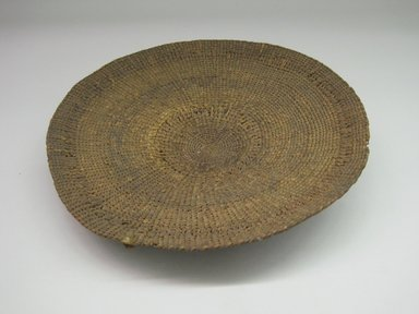 Hupa. <em>Basket Sifter for Acorn Flour</em>. Fiber, 1 15/16 × 11 1/2 × 11 1/2 in. (5 × 29.2 × 29.2 cm). Brooklyn Museum, Museum Expedition 1905, Museum Collection Fund, 05.588.7470. Creative Commons-BY (Photo: Brooklyn Museum, CUR.05.588.7470.jpg)