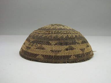 Hupa. <em>Woman's Basket Cap</em>. Fiber, 2 1/2 × 6 1/8 in. (6.4 × 15.6 cm). Brooklyn Museum, Museum Expedition 1905, Museum Collection Fund, 05.588.7483. Creative Commons-BY (Photo: Brooklyn Museum, CUR.05.588.7483.jpg)
