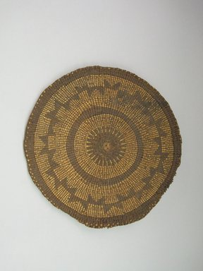 Hupa. <em>Basket Tray</em>. Fiber, 1 × 10 1/16 × 10 1/16 in. (2.5 × 25.5 × 25.5 cm). Brooklyn Museum, Museum Expedition 1905, Museum Collection Fund, 05.588.7527. Creative Commons-BY (Photo: Brooklyn Museum, CUR.05.588.7527.jpg)