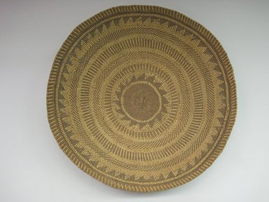 Yurok. <em>Winnowing Basket</em>. Fiber, willow, 4 3/4 × 16 7/8 × 16 13/16 in. (12.1 × 42.9 × 42.7 cm). Brooklyn Museum, Museum Expedition 1905, Museum Collection Fund, 05.588.7543. Creative Commons-BY (Photo: Brooklyn Museum, CUR.05.588.7543.jpg)