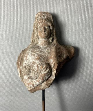 Greek. <em>Head and Upper Torso of Female Figure</em>, 5th century B.C.E. or 3rd-2nd century B.C.E. Terracotta, slip, 4 5/16 (height without tang) × 3 5/16 × 1 5/8 in. (11 × 8.4 × 4.2 cm). Brooklyn Museum, 05.7. Creative Commons-BY (Photo: Brooklyn Museum, CUR.05.7_view01.jpg)
