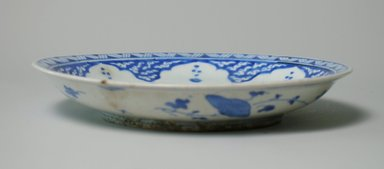<em>Plate</em>, 18th century. Ceramic, 1 5/8 x 9 9/16 in. (4.2 x 24.3 cm). Brooklyn Museum, Museum Collection Fund, 06.18. Creative Commons-BY (Photo: Brooklyn Museum, CUR.06.18_exterior.jpg)