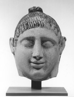 Graeco-Egyptian. <em>Mask of  a Lady</em>, late 1st century C.E. Plaster, pigment, 6 1/8 x 3 13/16 x 7 1/2 in. (15.5 x 9.7 x 19 cm). Brooklyn Museum, Museum Collection Fund, 06.282. Creative Commons-BY (Photo: Brooklyn Museum, CUR.06.282_NegA_print_bw.jpg)