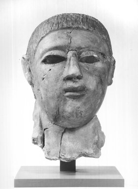 Graeco-Egyptian. <em>Mask of a Man</em>, late 2nd-early 3rd century C.E. Plaster, pigment, glass, 6 11/16 x 5 11/16 x 10 1/16 in. (17 x 14.5 x 25.5 cm). Brooklyn Museum, Museum Collection Fund, 06.287. Creative Commons-BY (Photo: Brooklyn Museum, CUR.06.287_NegA_print_bw.jpg)