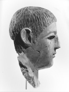 Graeco-Egyptian. <em>Mask of a Man</em>, late 2nd-early 3rd century C.E. Plaster, pigment, glass, 6 11/16 x 5 11/16 x 10 1/16 in. (17 x 14.5 x 25.5 cm). Brooklyn Museum, Museum Collection Fund, 06.287. Creative Commons-BY (Photo: Brooklyn Museum, CUR.06.287_NegE_print_bw.jpg)