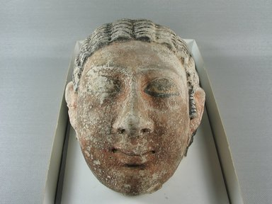 Graeco-Egyptian. <em>Mask of a Woman</em>, ca. 75-150 C.E. Plaster, pigment, 6 5/16 x 4 13/16 x 6 7/8 in. (16 x 12.3 x 17.5 cm). Brooklyn Museum, Museum Collection Fund, 06.289. Creative Commons-BY (Photo: Brooklyn Museum, CUR.06.289_view1.jpg)