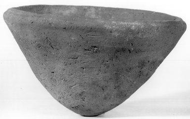 <em>Bowl or Cover</em>, ca. 3100-2675 B.C.E. Clay, 3 1/16 x  greatest diam. 5 1/2 in. (7.7 x 13.9 cm). Brooklyn Museum, Charles Edwin Wilbour Fund, 07.447.1365. Creative Commons-BY (Photo: Brooklyn Museum, CUR.07.447.1365_NegA_print_bw.jpg)