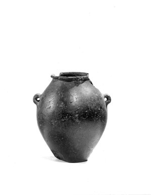 <em>Urn with Handles</em>, ca. 3500 B.C.E.-3300 B.C.E. Black serpentine (?), 2 1/2 x Greatest Diam. 2 3/16 in. (6.3 x 5.6 cm). Brooklyn Museum, Charles Edwin Wilbour Fund, 07.447.197. Creative Commons-BY (Photo: Brooklyn Museum, CUR.07.447.197_NegA_print_bw.jpg)
