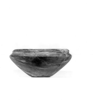 <em>Squat Bowl</em>, ca. 3100-2675 B.C.E. Limestone, 1 7/16 x Diam. 3 1/4 in. (3.7 x 8.3 cm). Brooklyn Museum, Charles Edwin Wilbour Fund, 07.447.203. Creative Commons-BY (Photo: Brooklyn Museum, CUR.07.447.203_NegA_print_bw.jpg)