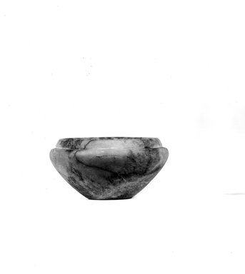 <em>Squat Bowl</em>, ca. 3100-2675 B.C.E. Marble, 1 9/16 x  Length 3 1/16 in. (3.9 x 7.7 cm). Brooklyn Museum, Charles Edwin Wilbour Fund, 07.447.204. Creative Commons-BY (Photo: Brooklyn Museum, CUR.07.447.204_NegA_print_bw.jpg)