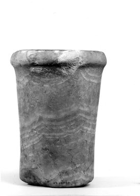 <em>Cylindrical Vase</em>, ca. 3100-2675 B.C.E. Egyptian alabaster (calcite), 6 3/4 x Diam. 4 13/16 in. (17.2 x 12.3 cm). Brooklyn Museum, Charles Edwin Wilbour Fund, 07.447.30. Creative Commons-BY (Photo: Brooklyn Museum, CUR.07.447.30_NegA_print_bw.jpg)