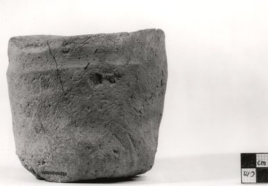 <em>Cylindrical Jar</em>, ca. 3100-2675 B.C.E. Clay, Measurements:  H. 9.8 cm, greatest diam. 11.1 cm, greatest diam. 13.9 cm, diam. of mouth 12.5 - 13.3cm, diam. of base 8 - 8.7 cm. Brooklyn Museum, Charles Edwin Wilbour Fund, 07.447.310. Creative Commons-BY (Photo: Brooklyn Museum, CUR.07.447.310_NegA_print_bw.jpg)