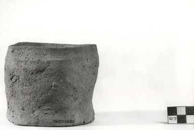 <em>Cylindrical Jar</em>, ca. 3100-2675 B.C.E. Clay, Measurements:  H. 8.6 cm, greatest diam. 10.8 cm, diam. of mouth 8.7 - 9.1 cm, diam. of base 9.3 cm. Brooklyn Museum, Charles Edwin Wilbour Fund, 07.447.312. Creative Commons-BY (Photo: Brooklyn Museum, CUR.07.447.312_NegA_print_bw.jpg)