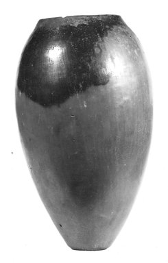 <em>Oval-shaped Vase</em>, ca. 3850-3500 B.C.E. Clay, 6 3/16 x Diam. 3 11/16 in. (15.7 x 9.4 cm). Brooklyn Museum, Charles Edwin Wilbour Fund, 07.447.347. Creative Commons-BY (Photo: Brooklyn Museum, CUR.07.447.347_NegA_print_bw.jpg)