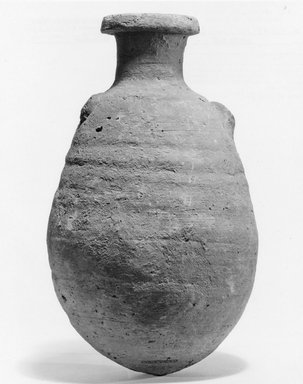 <em>Bottle with Grotesque Face</em>, ca. 1539-1292 B.C.E. Clay, 7 7/8 x Greatest Diam. 4 9/16 in. (20 x 11.6 cm). Brooklyn Museum, Charles Edwin Wilbour Fund, 07.447.481. Creative Commons-BY (Photo: Brooklyn Museum, CUR.07.447.481_negC_print.jpg)