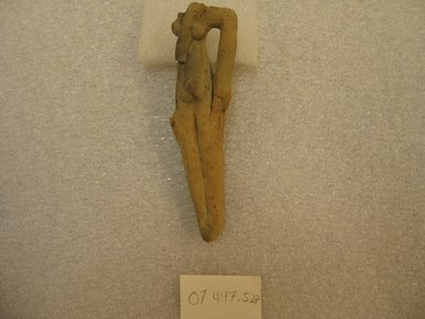 <em>Fragment of Figurine of Woman</em>, ca. 2008-1352 B.C.E. Clay, 4 3/16 x 1 x 15/16 in. (10.7 x 2.6 x 2.4 cm). Brooklyn Museum, Charles Edwin Wilbour Fund, 07.447.527. Creative Commons-BY (Photo: Brooklyn Museum, CUR.07.447.527.jpg)