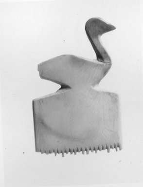 <em>Comb with Bird Decoration</em>, ca. 3500-3300 B.C.E. Ivory, 2 1/4 x 1 7/16 in. (5.7 x 3.7 cm). Brooklyn Museum, Charles Edwin Wilbour Fund, 07.447.764. Creative Commons-BY (Photo: Brooklyn Museum, CUR.07.447.764_NegB_print_bw.jpg)