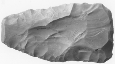 <em>Adze</em>, ca. 4400-2170 B.C.E. Flint, 1 11/16 x 3/8 x 3 1/4 in. (4.3 x 0.9 x 8.3 cm). Brooklyn Museum, Charles Edwin Wilbour Fund, 07.447.989. Creative Commons-BY (Photo: , CUR.07.447.989_NegA_print_bw.jpg)