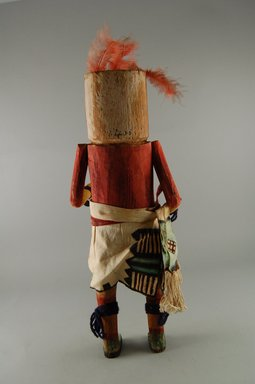She-we-na (Zuni Pueblo). <em>Kachina Doll (Uhuhu)</em>, late 19th century. Wood, feather, cotton, pigment, 14 3/16 x 5 1/16 x 3 11/16in. (36 x 12.8 x 9.4cm). Brooklyn Museum, Museum Expedition 1907, Museum Collection Fund, 07.467.8406. Creative Commons-BY (Photo: Brooklyn Museum, CUR.07.467.8406_back.jpg)
