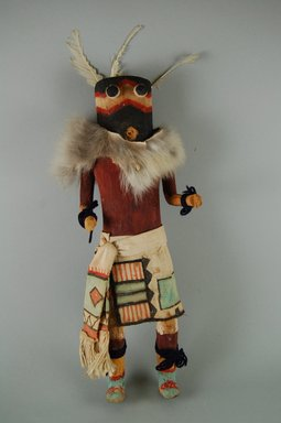 She-we-na (Zuni Pueblo). <em>Kachina Doll (Uhuhu)</em>, late 19th century. Wood, feather, hide, cotton, 13 3/4 x 4 13/16 x 2 3/4in. (35 x 12.3 x 7cm). Brooklyn Museum, Museum Expedition 1907, Museum Collection Fund, 07.467.8414. Creative Commons-BY (Photo: Brooklyn Museum, CUR.07.467.8414_front.jpg)