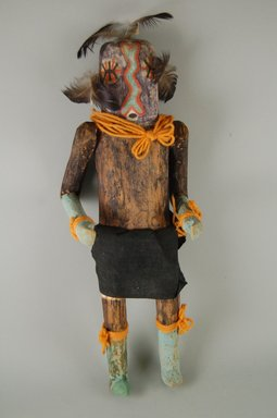 She-we-na (Zuni Pueblo). <em>Kachina Doll, (Kjna E Lona)</em>, late 19th century. Wood, cloth, pigment, feathers, 5 7/16 x 4 1/16 x 15 1/16in. (13.8 x 10.3 x 38.3cm). Brooklyn Museum, Museum Expedition 1907, Museum Collection Fund, 07.467.8421. Creative Commons-BY (Photo: Brooklyn Museum, CUR.07.467.8421_front.jpg)