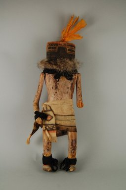 She-we-na (Zuni Pueblo). <em>Kachina Doll (Mokjachepa)</em>, late 19th century. Wood, hide, feather, cotton, pigment, fur, 13 3/8 x 2 15/16 x 4 13/16in. (34 x 7.5 x 12.2cm). Brooklyn Museum, Museum Expedition 1907, Museum Collection Fund, 07.467.8424. Creative Commons-BY (Photo: Brooklyn Museum, CUR.07.467.8424_front.jpg)