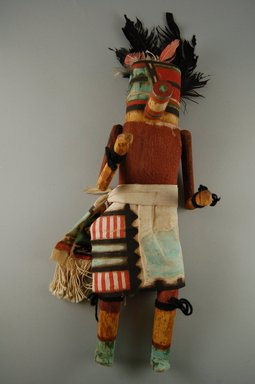 She-we-na (Zuni Pueblo). <em>Kachina Doll (Etatza Pona)</em>, late 19th century. Wood, cloth, feather, pigment, 4 5/8 x 3 11/16 x 15 1/4in. (11.7 x 9.4 x 38.7cm). Brooklyn Museum, Museum Expedition 1907, Museum Collection Fund, 07.467.8436. Creative Commons-BY (Photo: Brooklyn Museum, CUR.07.467.8436_front.jpg)