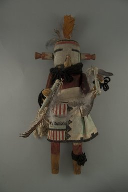 She-we-na (Zuni Pueblo). <em>Kachina Doll (Kuku-sheleh)</em>, late 19th century. Wood, cotton cloth, feathers, pigment,wool, 5 1/8 x 5 3/16 x 13 11/16in. (13 x 13.2 x 34.7cm). Brooklyn Museum, Museum Expedition 1907, Museum Collection Fund, 07.467.8438. Creative Commons-BY (Photo: Brooklyn Museum, CUR.07.467.8438_front.jpg)