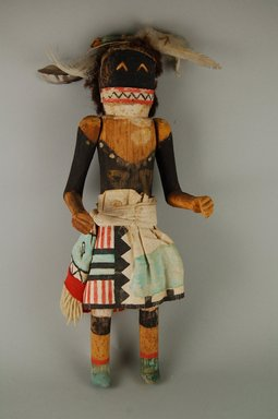 She-we-na (Zuni Pueblo). <em>Kachina Doll (Chakwana)</em>, late 19th century. Wood, feathers, cotton, fur, hide, 16 1/8 x 5 3/4 x 4 1/16in. (41 x 14.6 x 10.3cm). Brooklyn Museum, Museum Expedition 1907, Museum Collection Fund, 07.467.8441. Creative Commons-BY (Photo: Brooklyn Museum, CUR.07.467.8441_front.jpg)