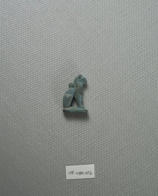 <em>Amulet of a Cat with Kitten</em>, ca. 1075-30 B.C.E. Faience, 1 x 11/16 in. (2.5 x 1.7 cm). Brooklyn Museum, Charles Edwin Wilbour Fund, 08.480.102. Creative Commons-BY (Photo: Brooklyn Museum, CUR.08.480.102_view2.jpg)