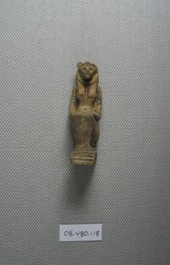 <em>Amulet of Lion-Head Goddess Crouching</em>, ca. 1075-30 B.C.E. Faience, 2 1/16 x 1 in. (5.3 x 2.5 cm). Brooklyn Museum, Charles Edwin Wilbour Fund, 08.480.118. Creative Commons-BY (Photo: Brooklyn Museum, CUR.08.480.118_View1.jpg)