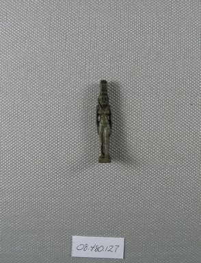 <em>Figure of Isis</em>, ca. 1075-656 B.C.E., or later. Faience, 1 1/2 x 5/16 x 7/16 in. (3.8 x 0.8 x 1.1 cm). Brooklyn Museum, Charles Edwin Wilbour Fund, 08.480.127. Creative Commons-BY (Photo: Brooklyn Museum, CUR.08.480.127_view1.jpg)