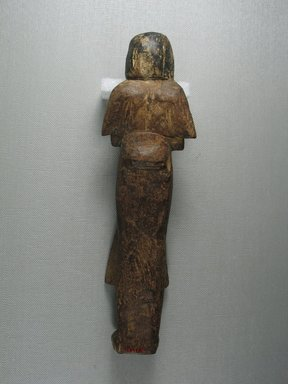 <em>Ushabti in the Dress of Life</em>, ca. 1292-1190 B.C.E., or much later. Wood, 9 7/16 x 2 5/8 x 1 9/16 in. (24 x 6.7 x 4 cm). Brooklyn Museum, Charles Edwin Wilbour Fund, 08.480.15. Creative Commons-BY (Photo: Brooklyn Museum, CUR.08.480.15_view4.jpg)
