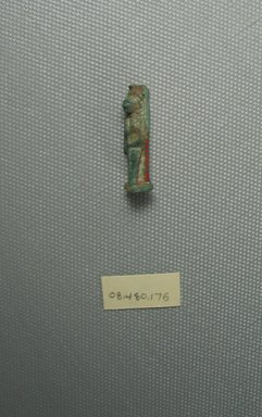 <em>Figure of a Standing Goddess</em>. Faience, 1 3/16 x 3/8 in. (3 x 1 cm). Brooklyn Museum, Charles Edwin Wilbour Fund, 08.480.175. Creative Commons-BY (Photo: Brooklyn Museum, CUR.08.480.175_View3.jpg)