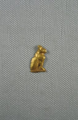 <em>Amulet - Seated Cat</em>, 664-30 B.C.E. Sheet gold, 3/4 x 7/16 in. (1.9 x 1.2 cm). Brooklyn Museum, Charles Edwin Wilbour Fund, 08.480.211. Creative Commons-BY (Photo: Brooklyn Museum, CUR.08.480.211_View1.jpg)